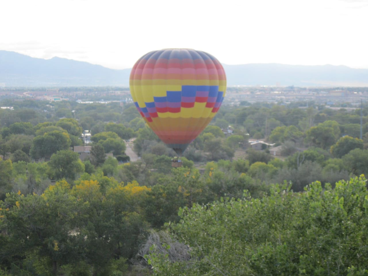 View all of Albuquerque (ABQ) including early morning sunrise, dazzling city lights and hot air balloons all from our east facing balcony, dining room or sitting area. This is a Splash-n-Dash as seen from the balcony.