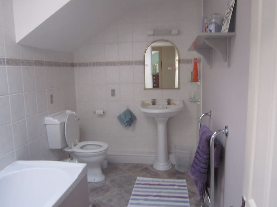 Bathroom with full bath and power-shower.