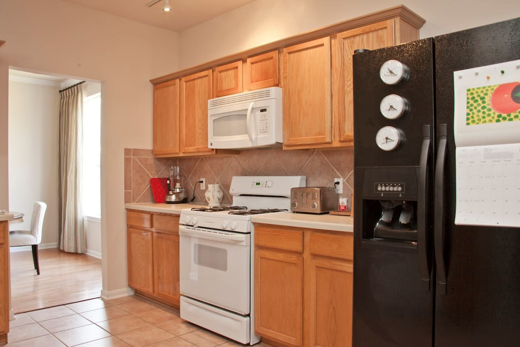 Gourmet kitchen with gas stove and ceramic tile.