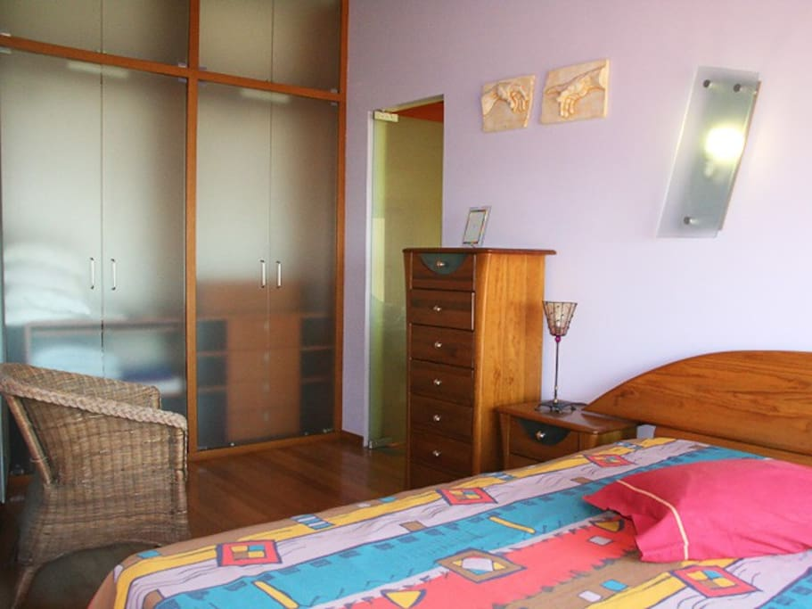 Double room with large wardrobes and plenty of cupboards and drawers