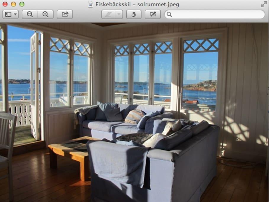 room inside balcony, windows on three sides. facing the sea