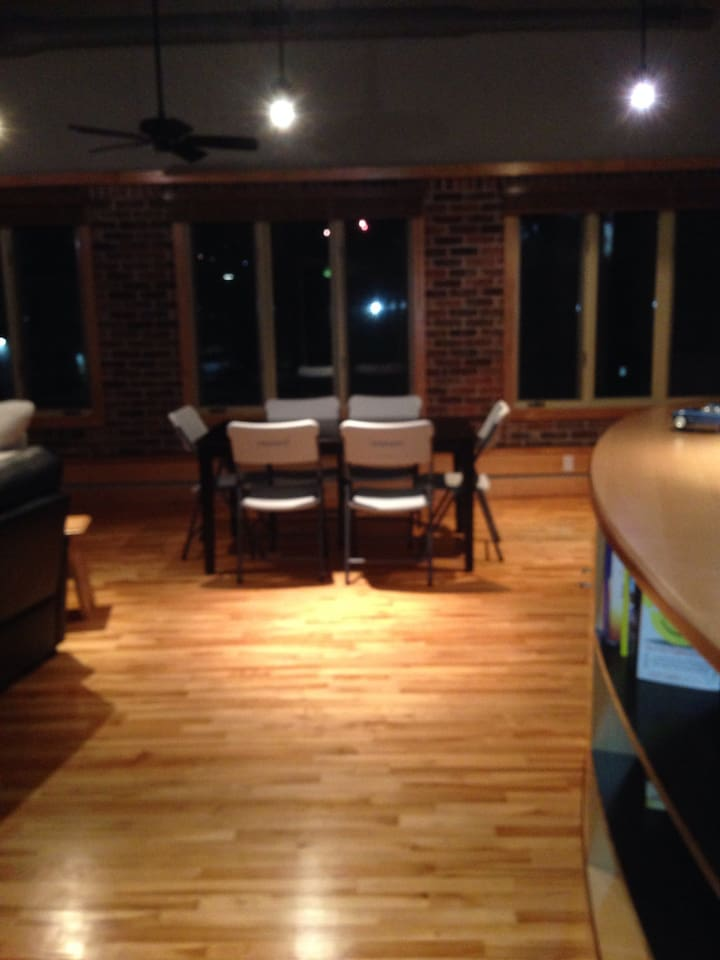 Large-spacious living room on second floor.  Dining room set with 8 chairs.