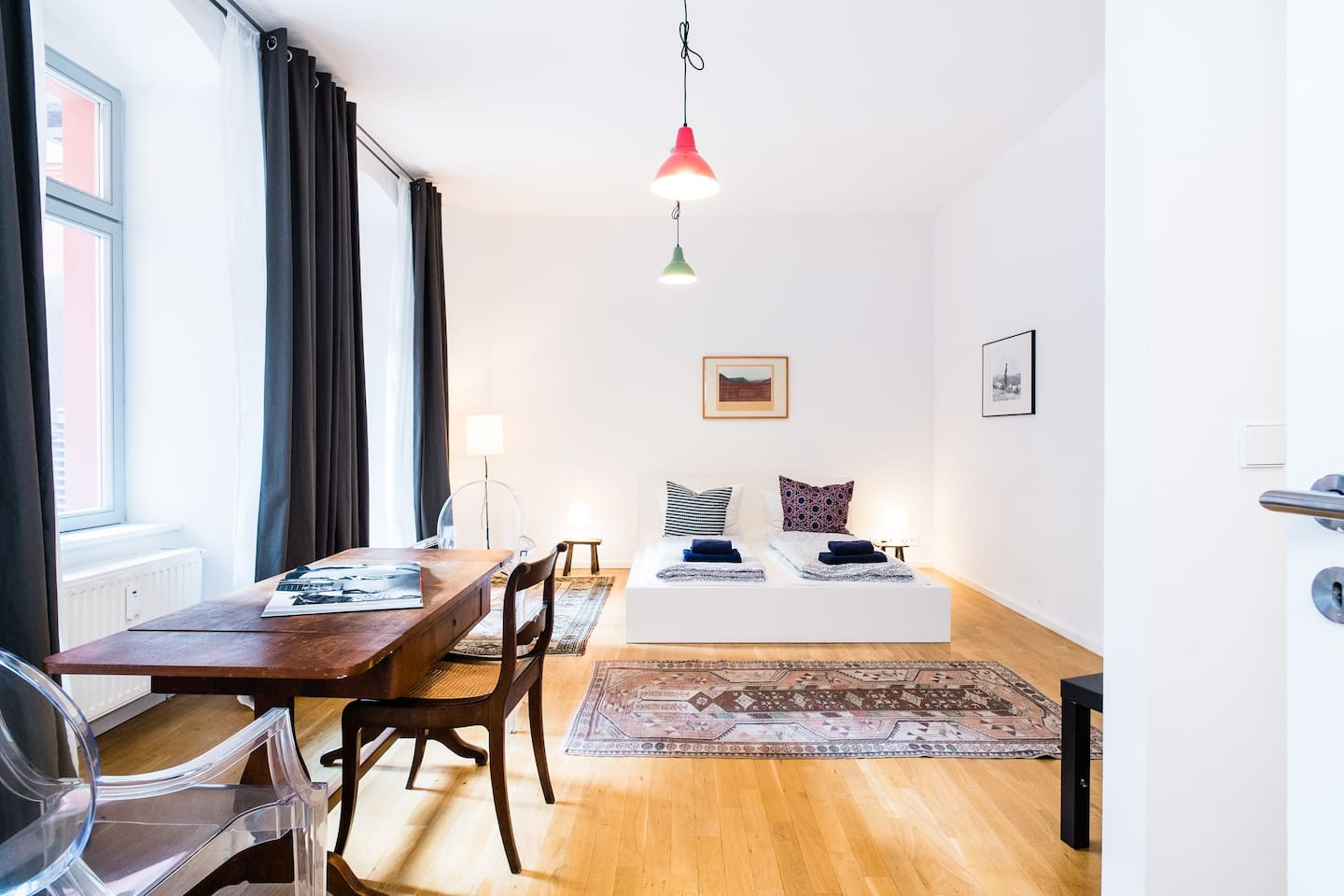 parquet flooring and big windows give a distinct feel to the flat