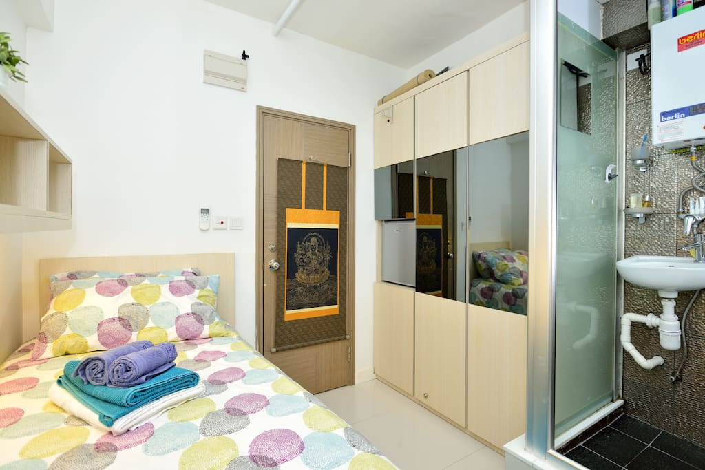 Room door, Big wardrobe, Shoewer, Bed , Desk is  out of angle.