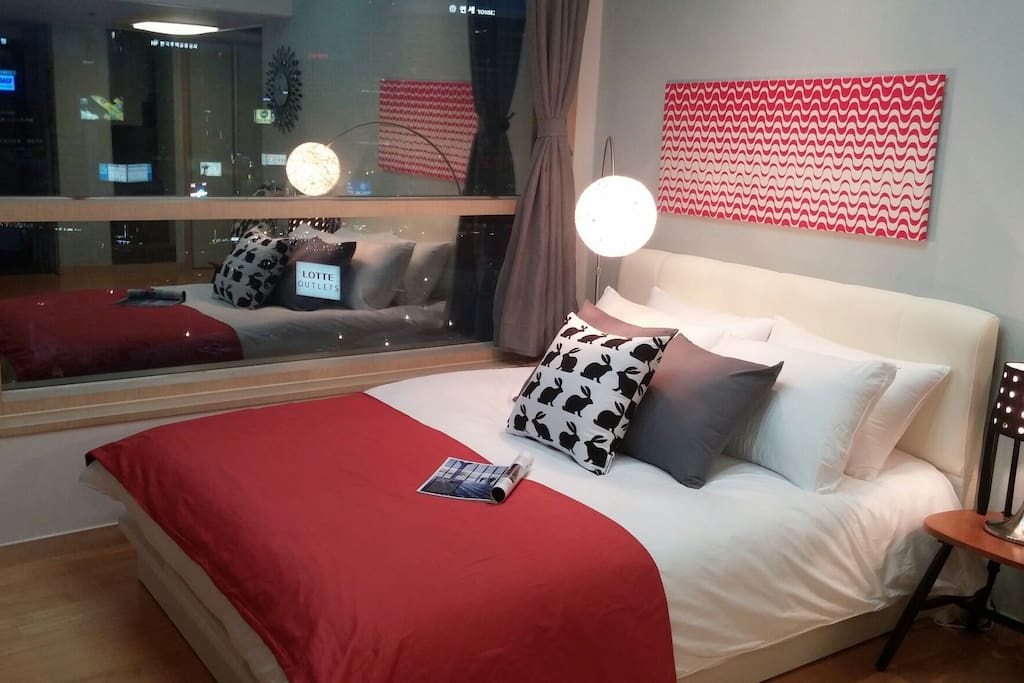 A queen sized bed with best quality bed linen on the 1st floor