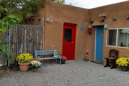 This adobe casita is in the heart of the Corrales, not far from Albuquerque  in a quiet, safe and rural area surrounded by Sage, Yarrow, Pine trees, Cacti and Roses.  It has a private a private entrance and free off-street parking.