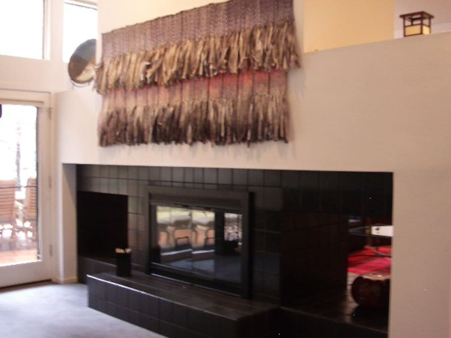 There is a double fireplace between the formal dining area and living room.