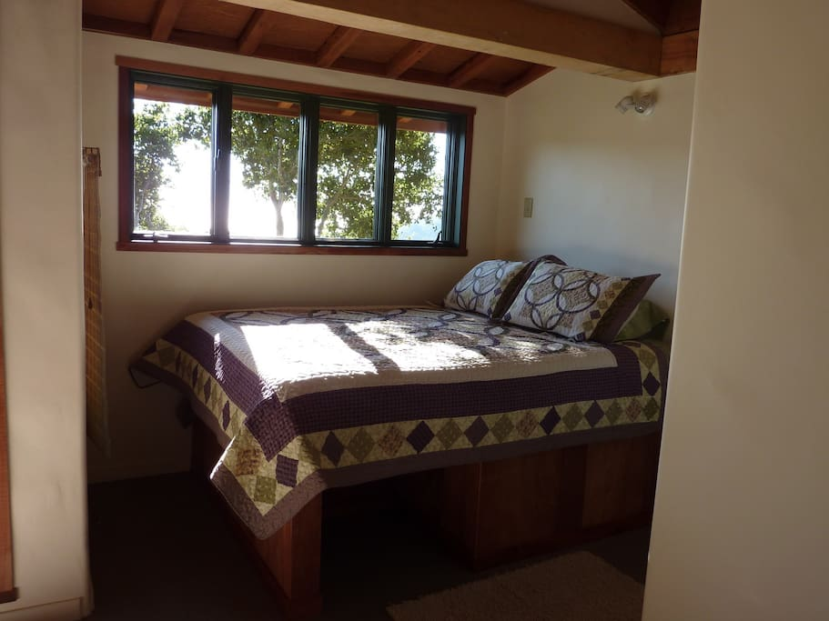 Cottage bedroom alcove with queen bed
