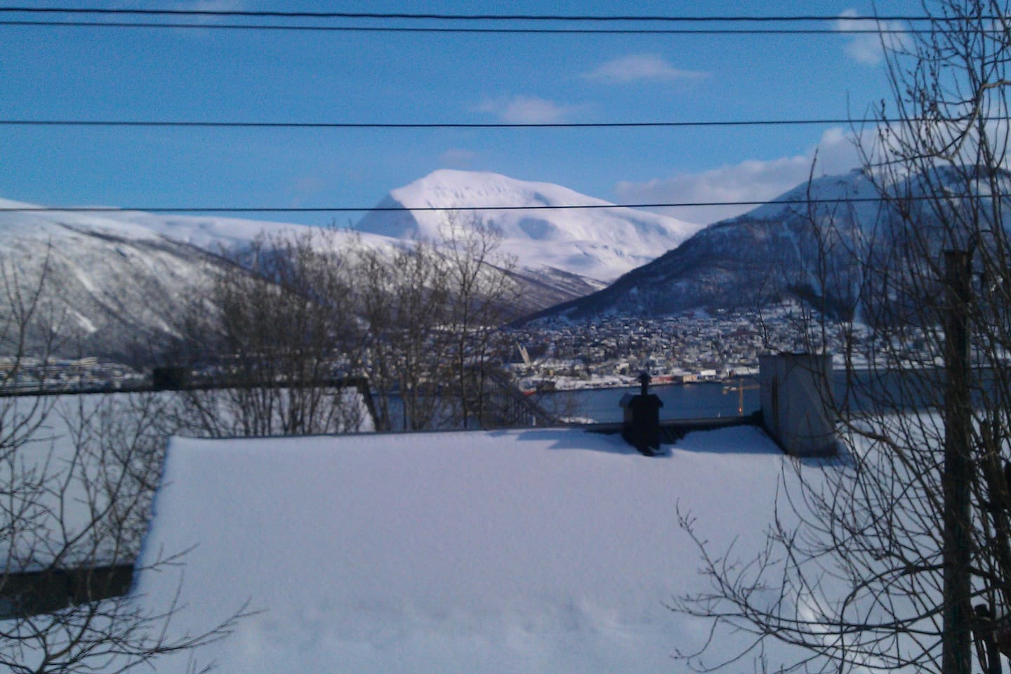 View toward Tromsdalen with Tromsdalstinden (the mountain) and Ishavskatedralen (the famous church in Tromsø)