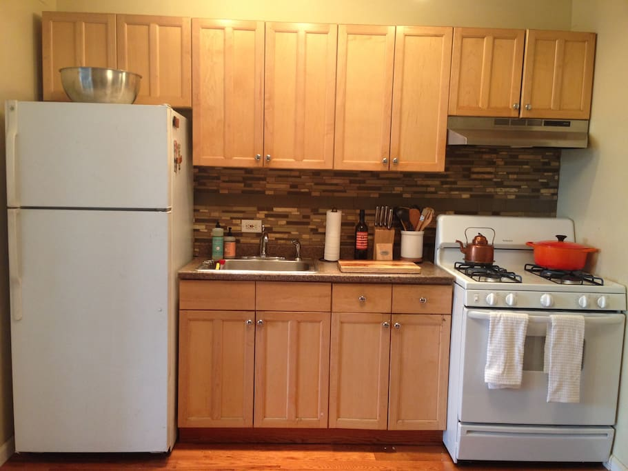 The kitchen has everything you need, minus a microwave.