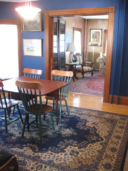 Living room and dining room are furnished with antiques.