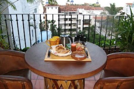 This condo is our second home. We make it as inviting as we would want it for ourselves.  It  is located on a quiet street overlooking beautiful Bay of Banderas and  the Zona Romantica.  If you are looking for JUST a rental, this is not for you!