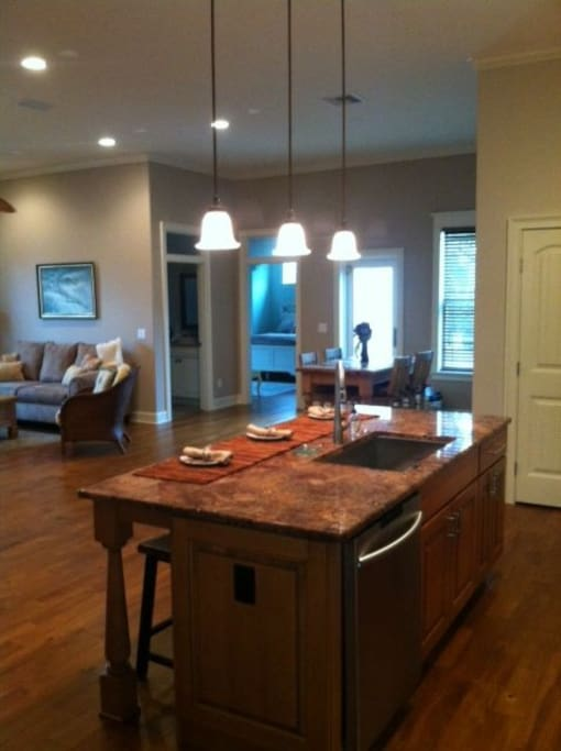 fully equipped kitchen, hardwood floors, and washer and dryer (new) inside.