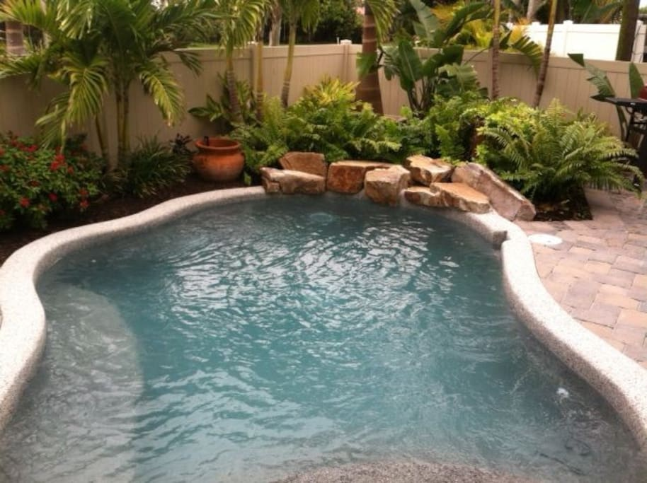 inground pool with gas grill, patio chairs and beach wagon! 16 homes from the Gulf of mexico.