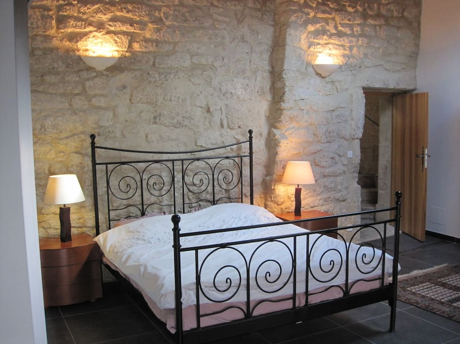 Main bedroom with its 14th century stone walls and 21st century with underfloor heating for the winter