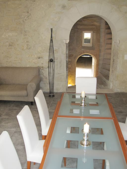 Dining area with a view to the spiral staircase and into the courtyard