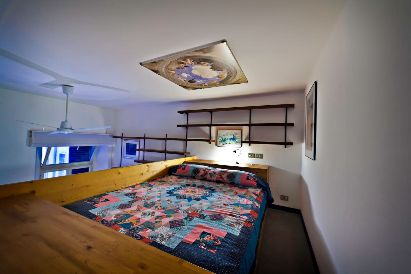 The romantic loft-style bedroom. The ceiling has a height of 194 cm.