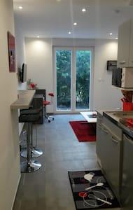 Beau studio avec jardin et terrasse - Audincourt - Apartament