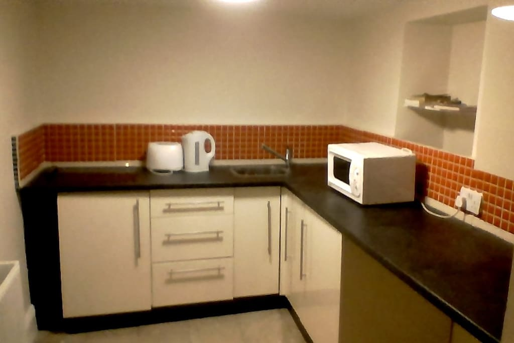 Kitchen equipped with microwave, hob, tea and coffee facilities