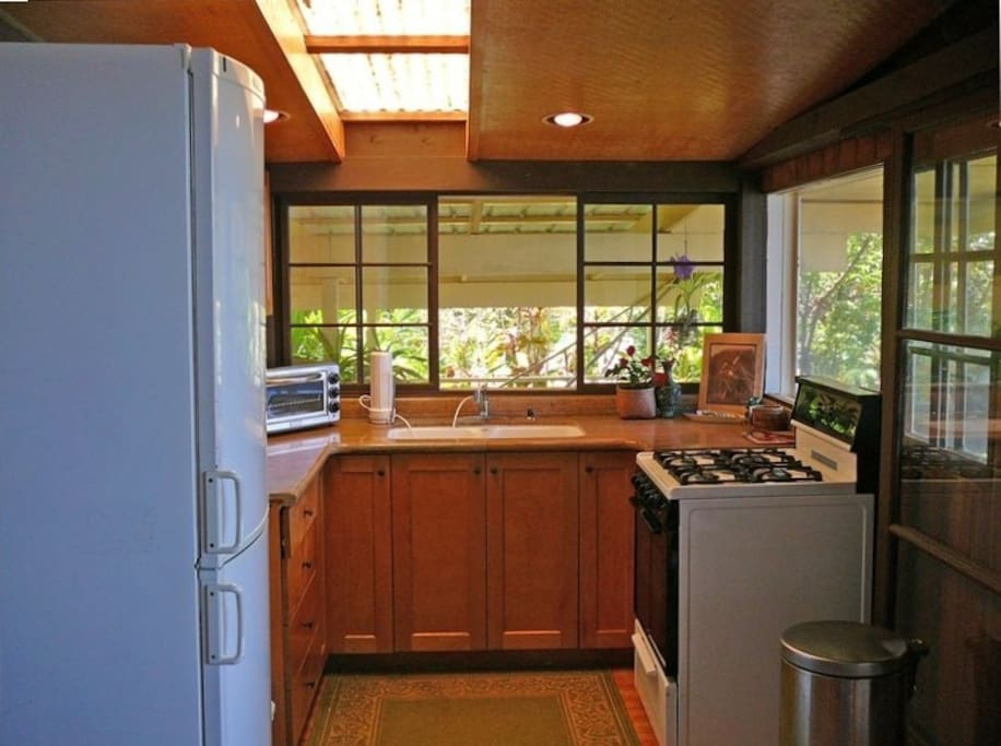 Kitchen is well-appointed with granite countertop and all the equipment you will need.