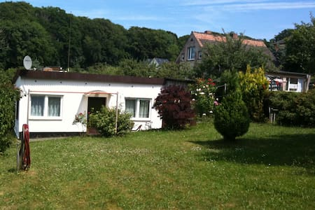We offer you a seaside Holiday cottage in lovely Binz. The beautiful beach are in walking distance just like the main street with its cafes and boutiques. The cottage is located in a quiet area of Binz with many gardens and small houses.