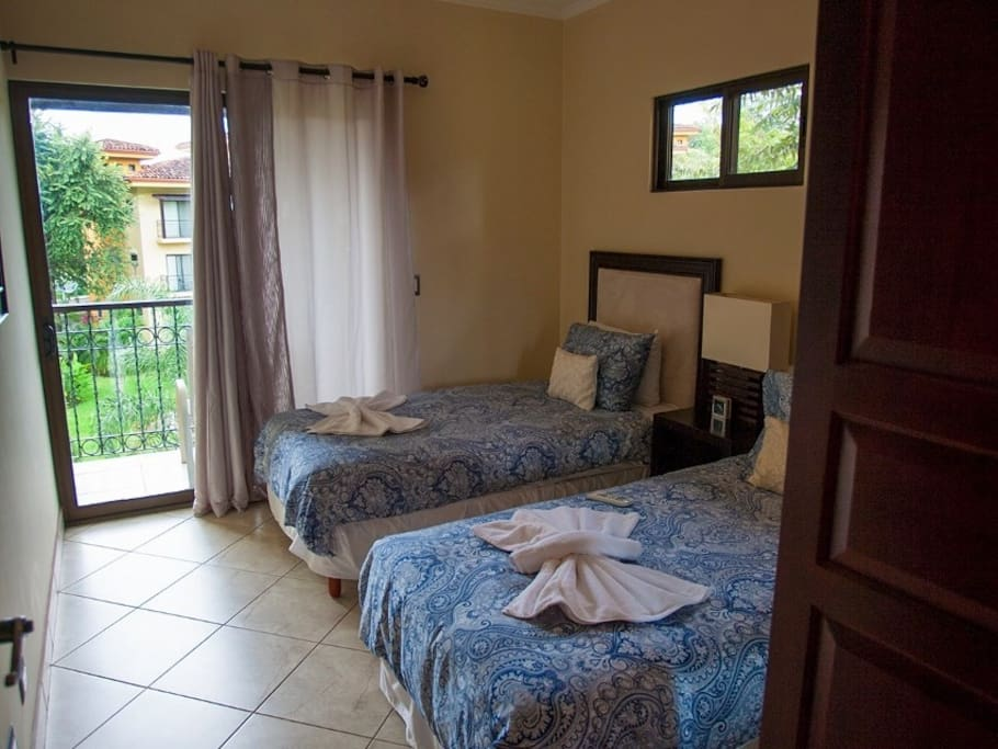 2 twin beds with own balcony overlooking the pool and grounds