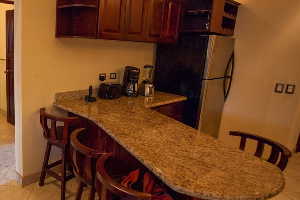 Granite counter top, fully equipped kitchen, stainless steel appliances