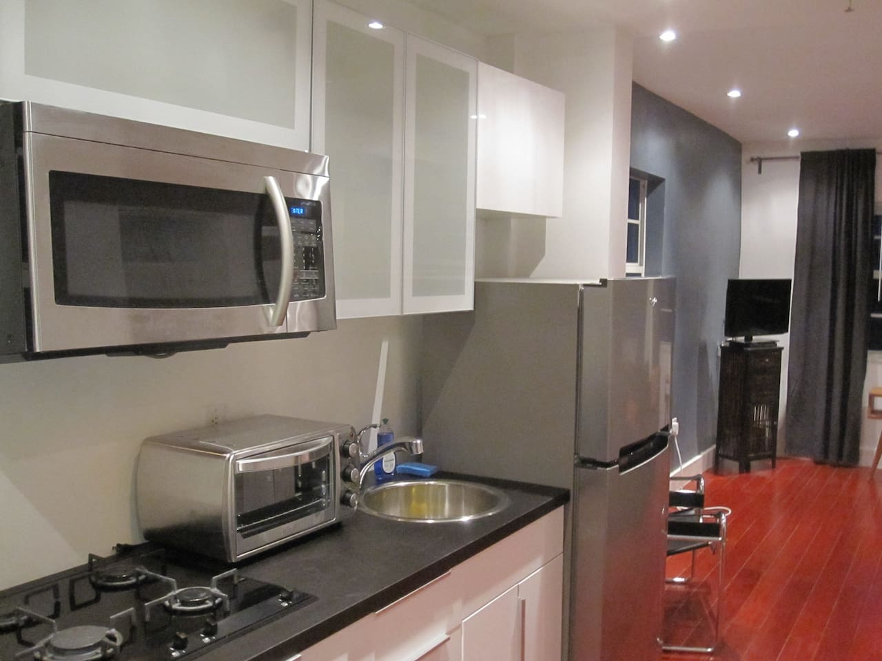 Fully equipped modern kitchen with gas cooktop