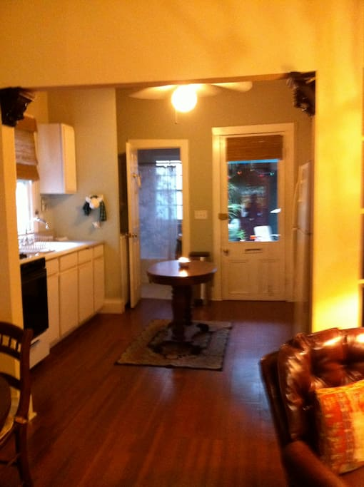View through the kitchen to the Cottage front door. Full bath is to the left of the front door.