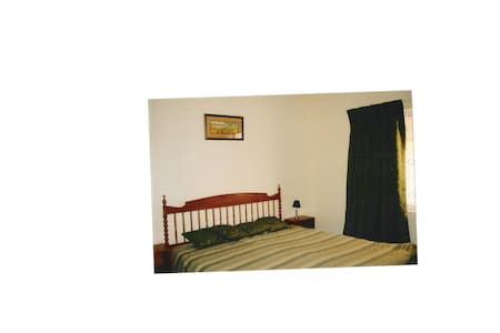 Independant ground floor large bedroom with tv lounge, dining room, kitchen, two bathrooms and living room. Fully furnished and serviced, wifi, cable tv, and small garden. Airconditioned and very comfortable. Ideal for short-term stay.