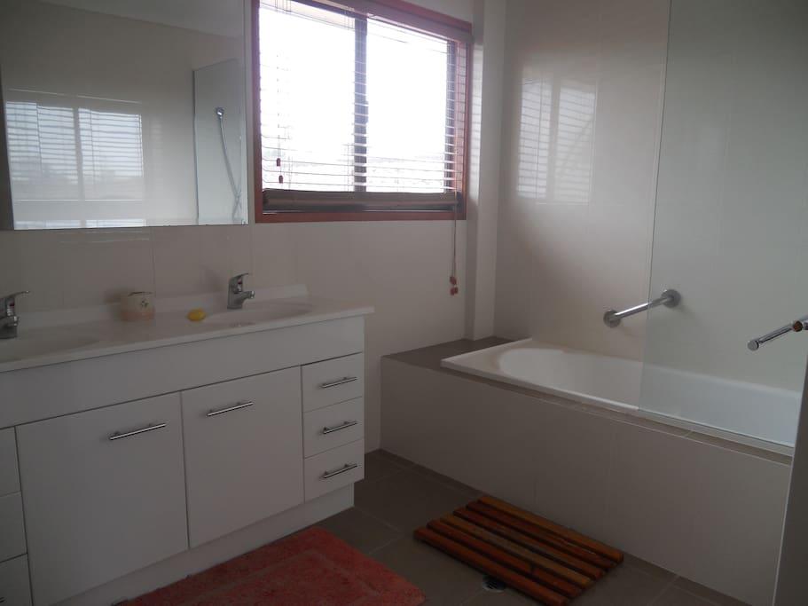 Shared bathroom has double sink