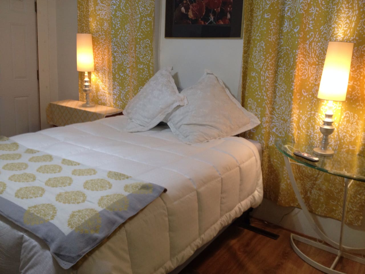 Large bedroom with queen size bed and TV