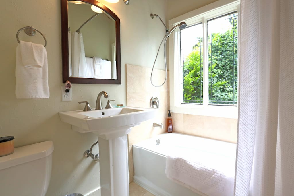 Marbled bath with large picture window
