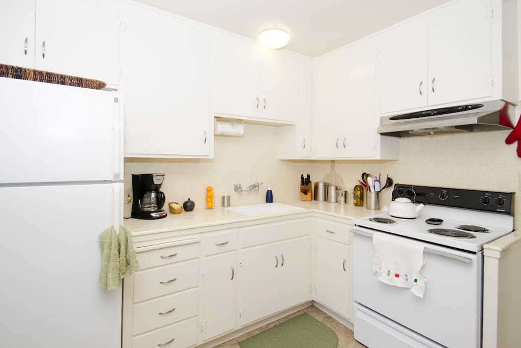 The fully-furnished kitchen has cabinet and refrigerator space for your groceries