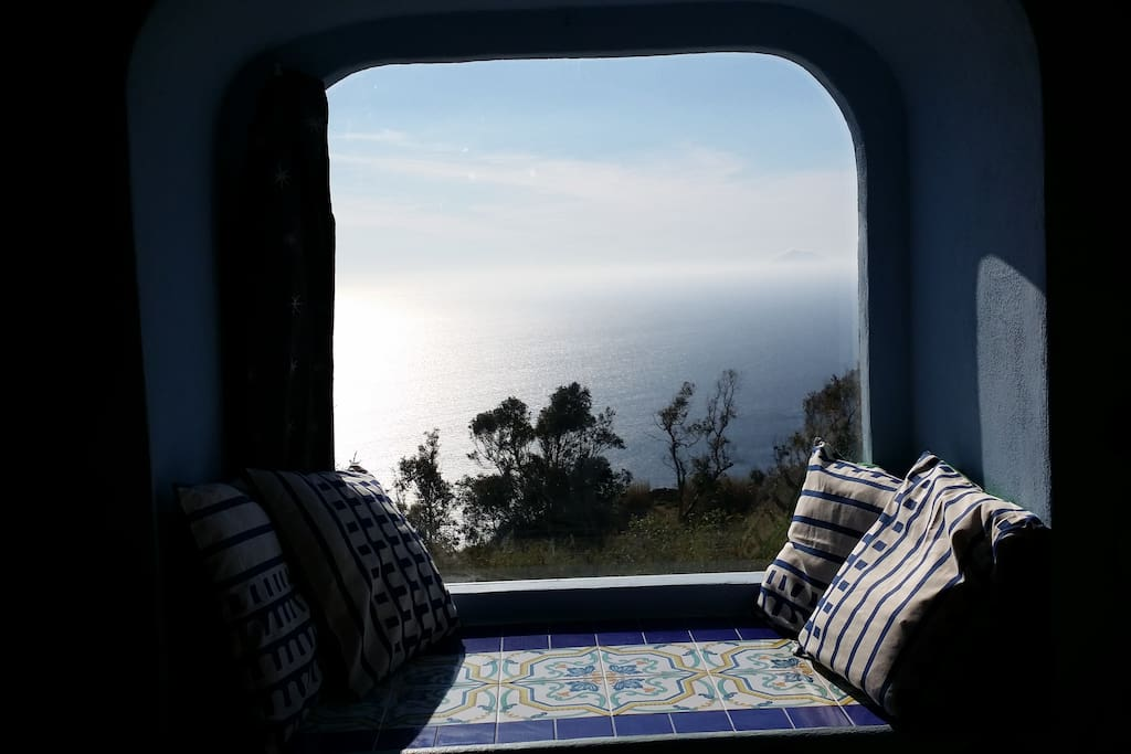 the window in the bedroom with sea view