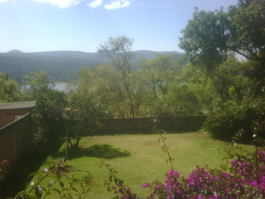 Partial view to the lake from living room window. Catch some rays from the garden!