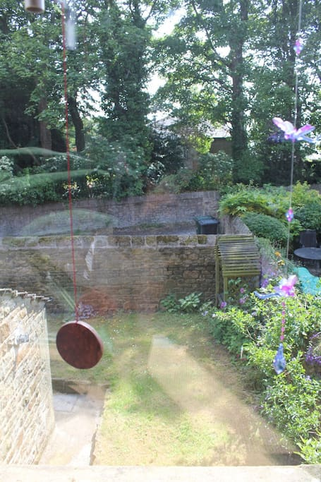 View from bedroom window onto garden belonging to basement apartment with separate entrance