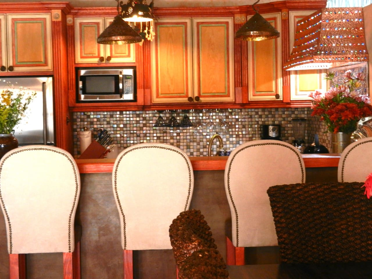Kitchen features bar so guests can help or watch you cook.