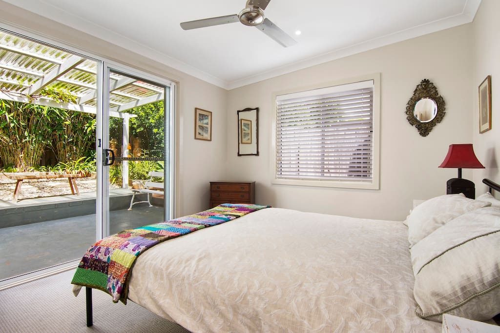 Queen sized bedroom ( there is a TV in the room )leads to a private garden.