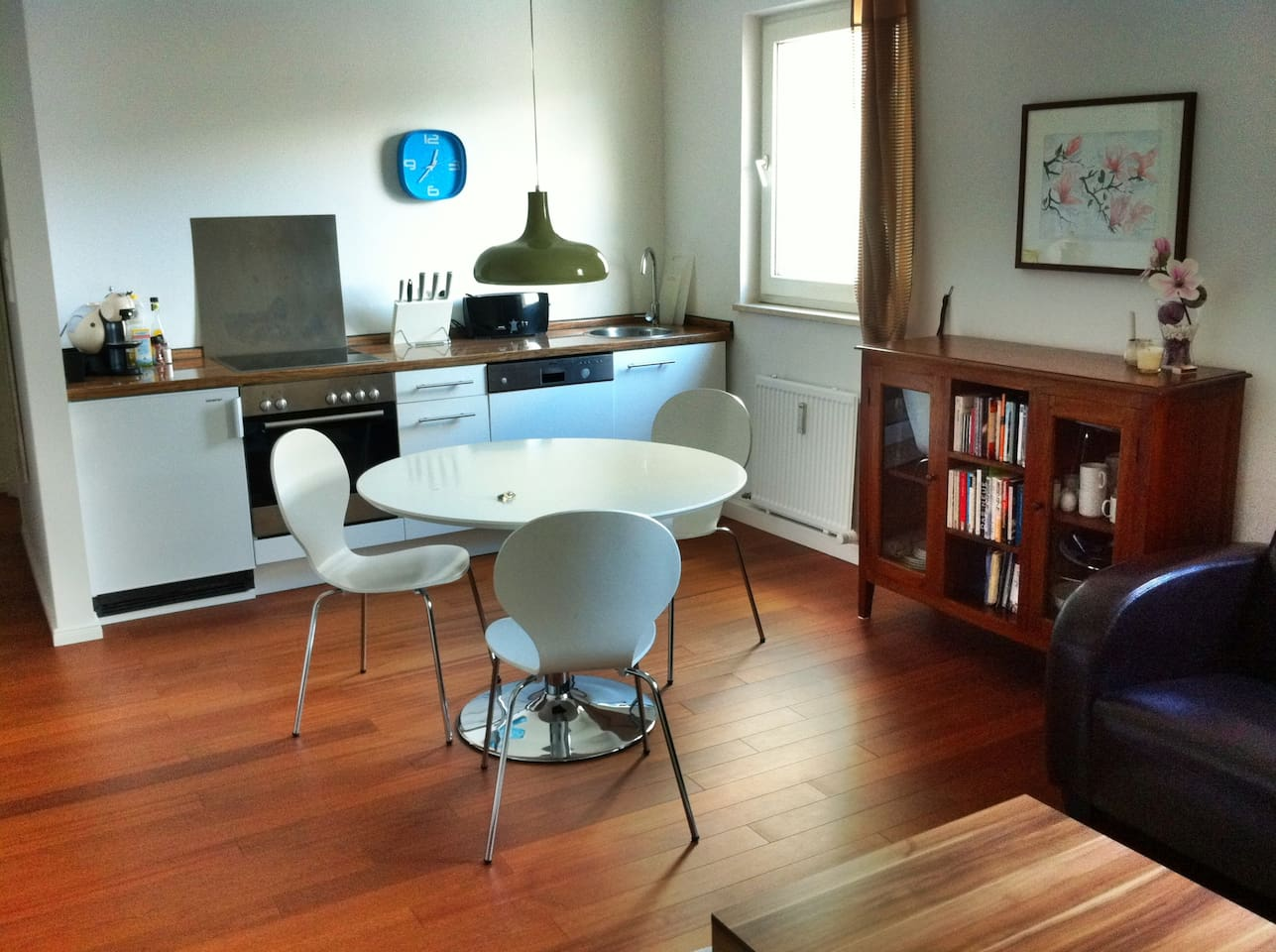 Living Room with kitchen and dining table.