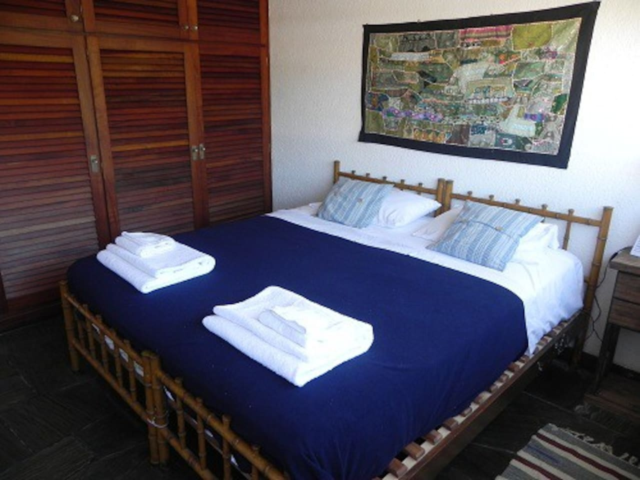Blue room with double bed.