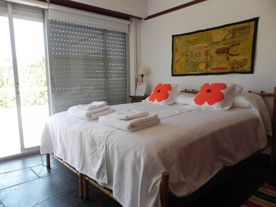 Orange room with double bed/private balcony.