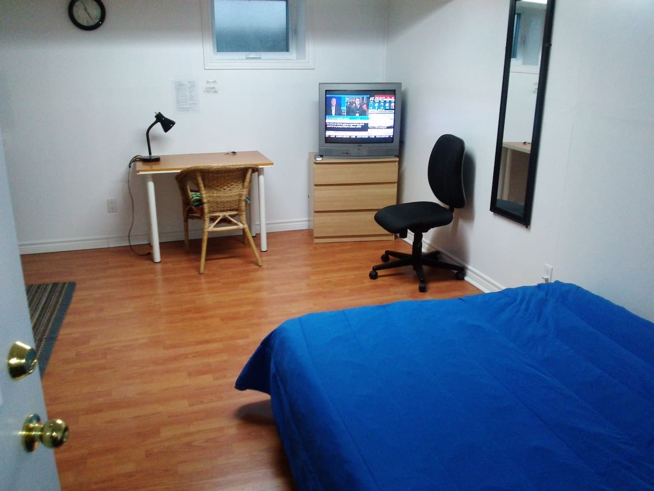 Writing table, small chest of drawers, Cable TV, 2 chairs.