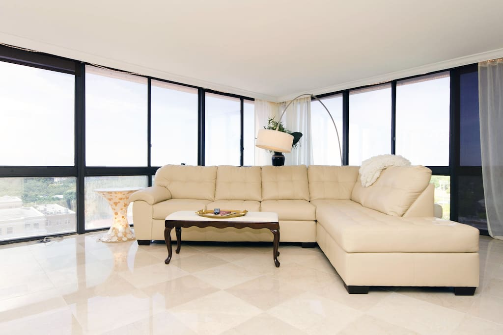 Contemporary white leather sofa, with suspended lamp.