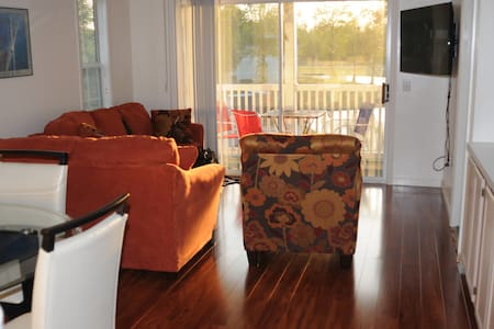 Relax after a day at the beach or golf course in a newly renovated condo.  Observe blue herons fishing in the lake as you kick back with a glass of wine on the patio or catch a movie on the large wall mounted flatscreen.