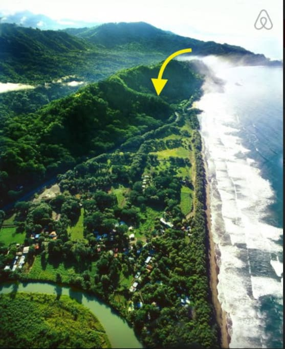 Arrow shows exact location of treehouse, Dominical, Rio Baru, and Pacific Coast Highway in foreground