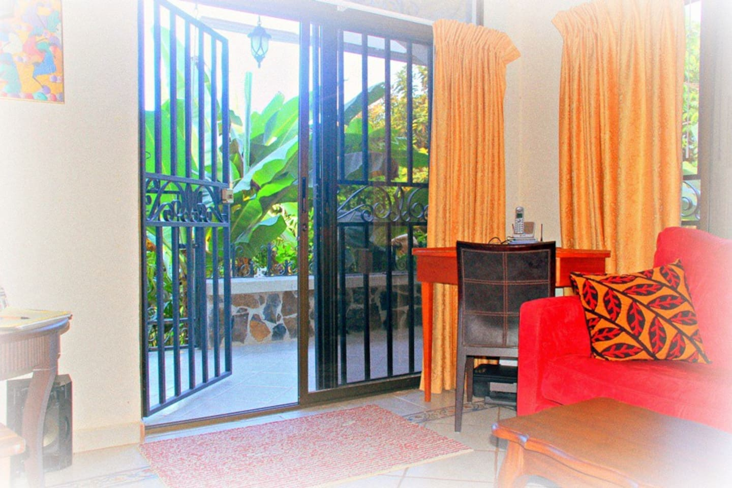 One view to terrace from living room, note secure iron gates