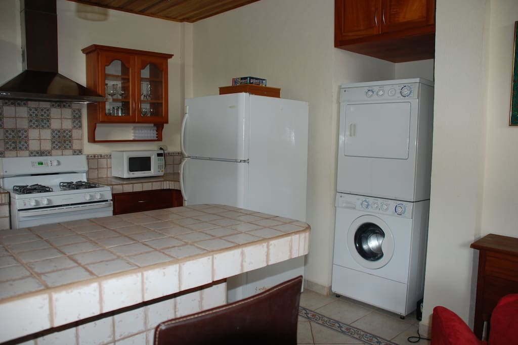 Fully equipped kitchen with washer/dryer, gas stove with oven