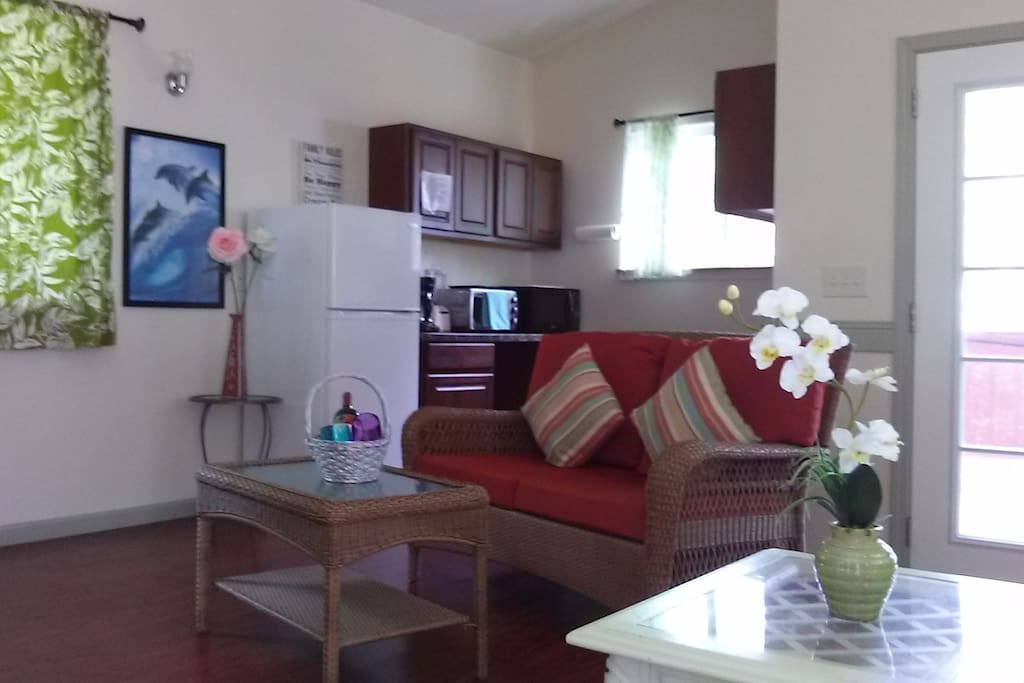 Spacious living room and a food prep area in The Dolphin Cottage.