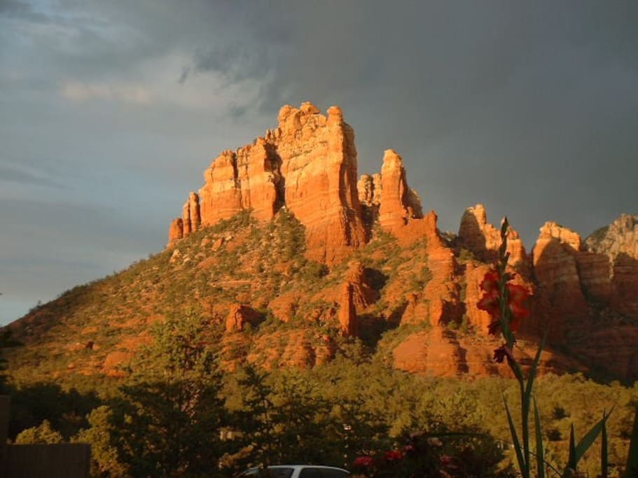 Sunset colors and dark clouds over Snoopy Rock. View from our property!
